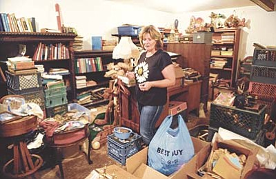 Les Stukenberg/The Daily Courier<br>Prescott resident Colleen Carr still has a lot of stuff to look through, even after the American Pickers crew stopped by, in the home she inherited from her uncle Victor Buck. Carr said she liked the American Pickers experience and they paid her about $2,100 for the items they bought on the show that aired on August 19.