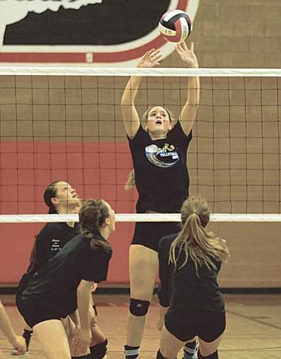 Les Stukenberg/The Daily Courier<br /><br /><!-- 1upcrlf2 -->Prescott's Alex Koehler taps home a winner during a volleyball scrimmage between the Bradshaw Mountain Bears and the Prescott Badgers Thursday night in Prescott Valley.