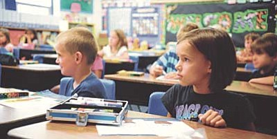 Les Stukenberg/The Daily Courier<br /><br /><!-- 1upcrlf2 -->Gunnar Shindledecker, Anita Mauzy and the rest of Kim Dillon's second grade class at Lincoln Elementary School listen to a story Thursday afternoon.