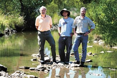 The Prescott Creeks organization is celebrating its 25th anniversary Sept. 19. Pictured in Granite Creek are from left Development Communications Manager Peter Pierson, Conservation Projects Manager Guy Whol and Executive Director Michael Byrd.<br /><br /><!-- 1upcrlf2 -->(Les Stukenberg/The Daily Courier)