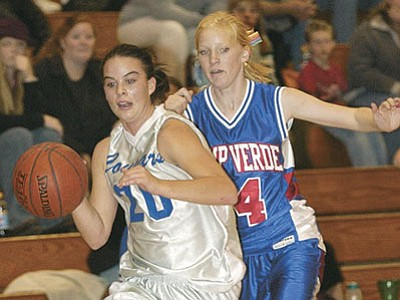 The Daily Courier, file photos<br> Kelly Smith, above, and Stacy Haddow, below, lend their abilities to the Chino Valley Lady Cougars' efforts in 2003. The pair, along with a host of former Cougars, will be inducted into the high school's Hall of Fame on Friday, Sept. 4.