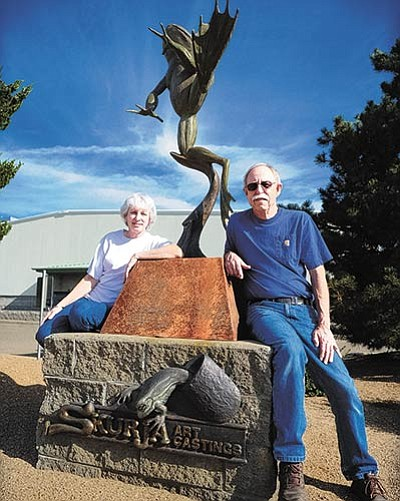 Les Stukenberg/The Daily Courier<br> Shannon and John Skurja pose outside their Prescott location of Skurja Art Castings where they and their staff make bronze works for themselves and artists from around the country.