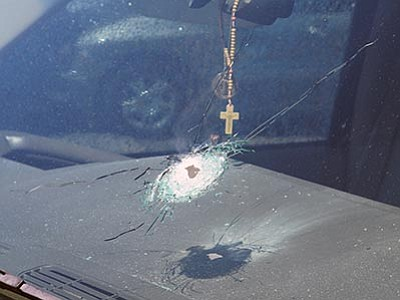 DPS via AP<br> This undated photo released by the Arizona Department of Public Safety shows a bullet hole in the windshield of a vehicle in Phoenix. A number of vehicles traveling Interstate 10 in Phoenix have been struck by gunshots in the past two weeks, and the state police agency is appealing for information from the public as it conducts what it says is a robust investigation.
