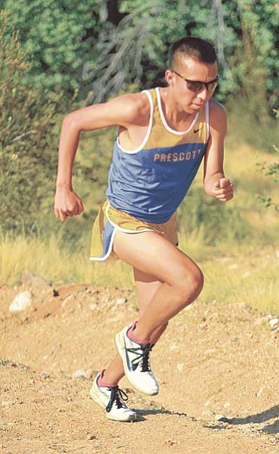 Matt Hinshaw/The Daily Courier file<br /><br /><!-- 1upcrlf2 -->Prescott's Nakai Lake powers up a hill earlier this season at Embry-Riddle Aeronautical University for Prescott's season and home opening cross country meet.