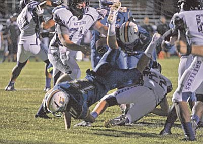 Matt Hinshaw/The Daily Courier<br /><br /><!-- 1upcrlf2 -->Prescott's Ryan Greene (17) leaps over North Canyon's Tre O'Guinn (22) and the goal line scoring the third touchdown of the game for Prescott Friday night September 11 at PHS.