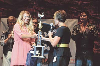Matt Hinshaw/The Daily Courier<br /><br /><!-- 1upcrlf2 -->Becky Karcie hands Gaby Perez her trophy.