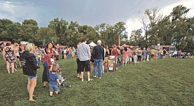 Matt Hinshaw/The Daily Courier<br /><br /><!-- 1upcrlf2 -->People wait in line for the Gringo Dillas food truck from Flagstaff Saturday afternoon September 12 during the first Prescott Food Truck Festival at Mile High Middle School.