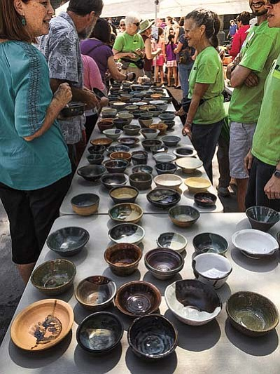 Handcrafted ceramic bowls await their chance to be filled at the Empty Bowls event Sunday, Sept. 13, in downtown Prescott. (Photos by Arlene Hittle/The Daily Courier)