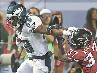 John Bazemore/The AP<br> Philadelphia Eagles running back DeMarco Murray runs around Atlanta Falcons cornerback Ricardo Allen during the second half of their game Monday, Sept. 14, in Atlanta.