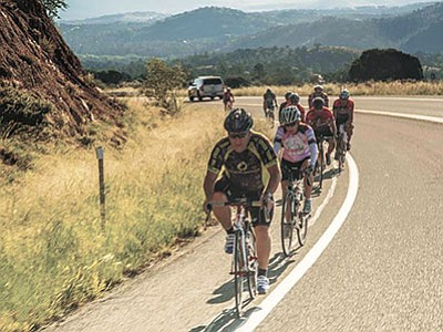Courtesy photo<br> Riders in the Skull Valley Loop Challenge enjoy one of the downhill portions of the ride.