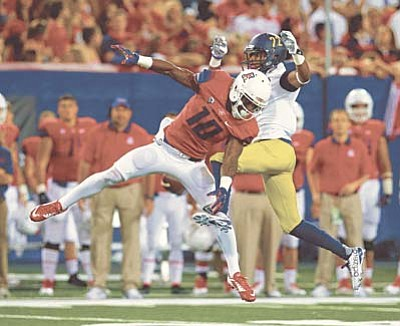 Northern Arizona cornerback Marcus Alford breaks up a pass intended for Arizona wide receiver Samajie Grant (10) during the first half of an NCAA college football game, Saturday, Sept. 19, 2015, in Tucson, Ariz. (AP Photo/Rick Scuteri)