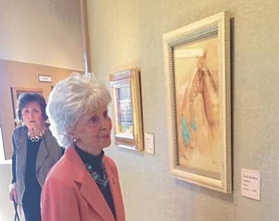 Jason Wheeler/Daily Courier<br /><br /><!-- 1upcrlf2 -->During the Phippen Museum's Fall Gathering, Wanda Miller took some time to enjoy the artwork Saturday evening.