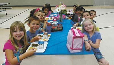 Students chosen as responsible students sit at a special table for lunch. <br /><br /><!-- 1upcrlf2 -->(Courtesy photos)