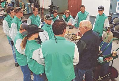 JTED students from local high schools listen intently to welding instructor Dave Perey at the Yavapai College Career and Technical Education Center.