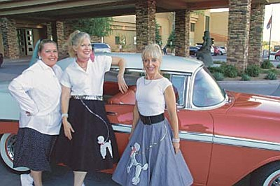 Max Efrein/The Daily Courier<br /><br /><!-- 1upcrlf2 -->Jeanie Carroll (left) Susannah Martin and Shondra Jepperson make up The Sedona Dynamite Divas. They performed Saturday evening at the annual People Who Care Senior Prom.