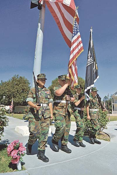 Matt Hinshaw/The Daily Courier<br /><br /><!-- 1upcrlf2 -->The Granite Mountain Young Marines present the colors to start the Bob Stump VA Medical Center's 2015 Recognition Ceremony for National POW/MIA Recognition Day Friday morning at the VA in Prescott.