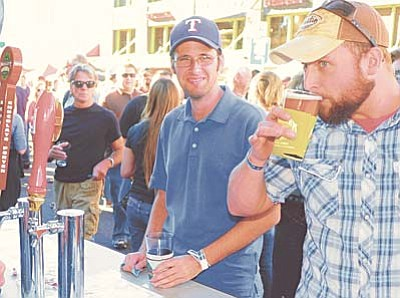 Les Stukenberg/The Daily Courier<br>Justin Turk takes a drink from his freshly filled pint during last year's Octoberfest celebration in downtown Prescott.