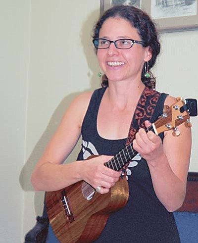 Sue Tone/The Daily Courier<br>Marieke Slovin performs three of her original story-to-song compositions at the High Noon Toastmasters Open House Sept. 9. She will play her music Friday from 7-10 p.m. at the Black Hole in Prescott.