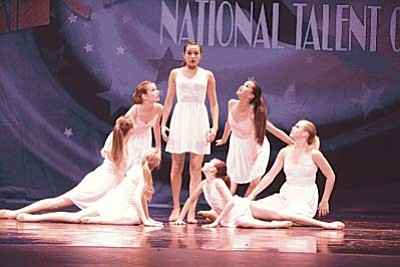 "Courtesy photo<br>Summer's DanceWorks dancers perform ""Let It Be."""