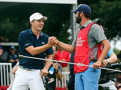 John Bazemore/The AP<br> Jordan Spieth, left, celebrates with his caddie after winning the Tour Championship golf tournament and the FedEx Cup at East Lake Golf Club, Sunday, Sept. 27, in Atlanta.