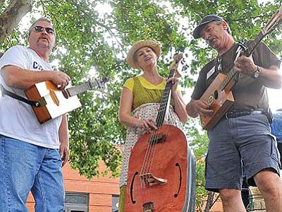 The Dirtbilly Jugnots Jugless Gospel Jug Band warms up before their 2011 performance during the annual Folk Music Festival at Sharlot Hall Museum. (Matt Hinshaw/The Daily Courier, file)