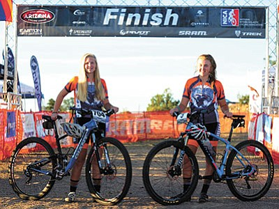 Les Stukenberg/The Daily Courier<br> Phoebe and Zoe Dunn pose before the Arizona High School Cycling League Prescott race at the Brownlow Trail system at Pioneer Park Sunday morning, Sept. 27.