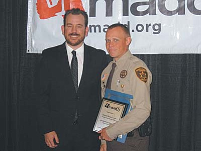 Courtesy YCSO<br /><br /><!-- 1upcrlf2 -->Deputy Michael Lewis with MADD Program Director in Phoenix, Jason Frazier