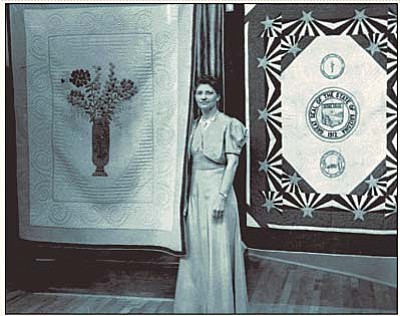 "Courtesy Sharlot Hall Museum<br>Emma Andres with two of her prize-winning quilts, ""The Tillman Quilt"" and ""Arizona State Flag."""