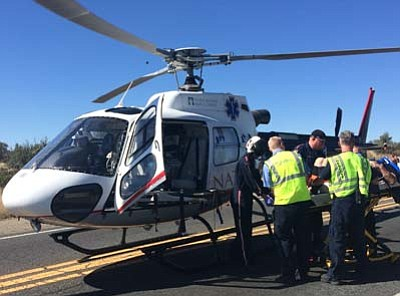 A medical helicopter landed on Highway 89 Sunday to transport a man injured in a six-vehicle accident. (Photo courtesy of Jeff Jones/Prescott Fire Department)