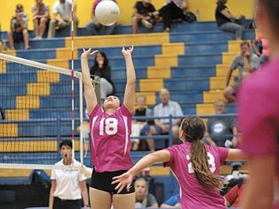 Matt Hinshaw/The Daily Courier<br> Prescott's Erinn Marroquin (18) sets the ball for teammate Ashlynn Uvila (23) while La Joya's Elizabeth Leuck (11) looks on Tuesday night at Prescott High School.  Prescott beat La Joya in three sets.