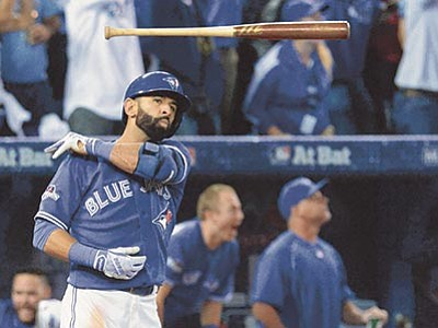 Chris Youn/The Canadian Press via AP<br> Blue Jays Jose Bautista tosses his bat after hitting a three-run home run during the seventh inning in Game 5 of baseball's American League Division Series, Wednesday, Oct. 14 in Toronto.