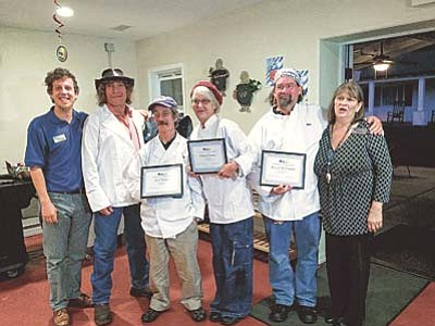 "Nanci Hutson/The Daily Courier<br>The U.S. VETS Initiative's fall culinary program staff and graduates: AmeriCorp Vista Program Supervisor Will Heineke Jr. and students, from left, Richard Roman, Earl Teater, Debra Owen and David ""Mickey"" McDonald and culinary instructor and VIP kitchen manager Carolyn Baca."