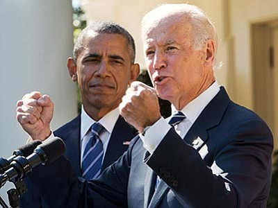 Jacquelyn Martin/The AP<br> Vice President Joe Biden, with President Barack Obama, gestures as he speaks in the Rose Garden of the White House in Washington, Wednesday, Oct. 21, to announce that he will not run for the presidential nomination.
