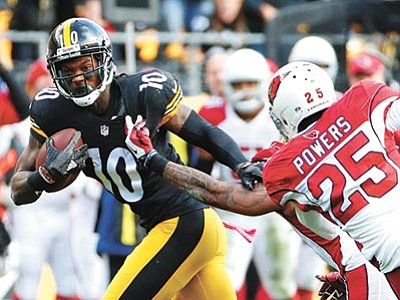 Gene J. Puskar/The AP<br> Pittsburgh Steelers wide receiver Martavis Bryant tries to get away from Arizona Cardinals free safety Rashad Johnson after making a catch in the second half of their game  Sunday, Oct. 18, in Pittsburgh. The Steelers won 25-13.