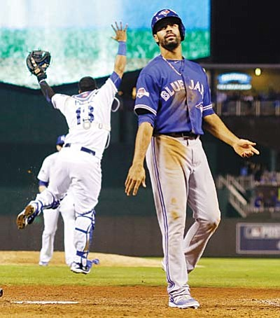 Toronto Blue Jays' Dalton Pompey looks away as Kansas City Royals celebrates their 4-3 win in Game 6 of baseball's American League Championship Series on Friday, Oct. 23, 2015, in Kansas City, Mo. (AP Photo/Matt Slocum)