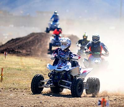 Prescott Valley - October 24, 2015<br /><br /><!-- 1upcrlf2 -->Les Stukenberg/The Daily Courier<br /><br /><!-- 1upcrlf2 -->Dirt bikes, quads, UTV's and even a sidecar race in the first ever Prescott Valley Grand Prix in the fields in front of the PV Event Center Saturday. Racing action continues Sunday beginning at 8 a.m.