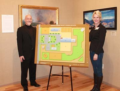 Yavapai Humane Society Executive Director Ed Boks, left, and YHS pro bono equine consultant Nina Ekholm Fry present the YHS Equine Initiative track system design at the Helping Our Horses event at the Phippen Museum Saturday, Oct. 24. (Courtesy photos)