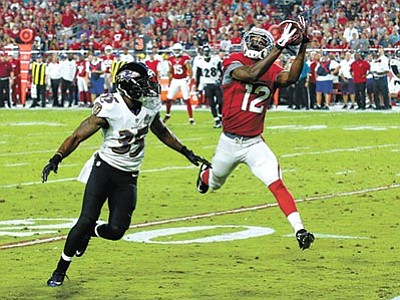 AP Photo/Ross D. Franklin<br> Arizona Cardinals wide receiver John Brown pulls in a pass as Baltimore Ravens defensive back Shareece Wright defends during the second half Monday, Oct. 26, in Glendale.