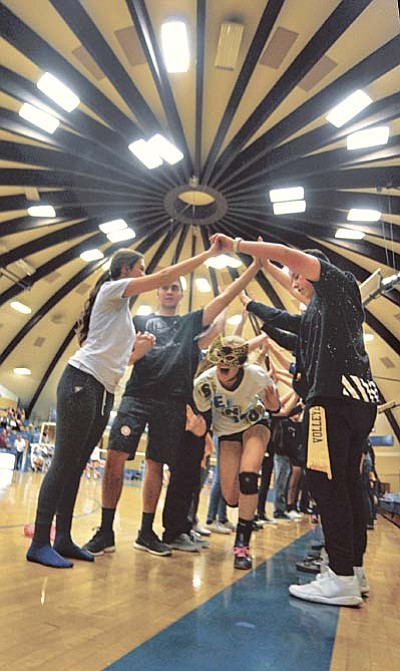 Matt Hinshaw/The Daily Courier<br>Prescott's Bailey Anderson runs through a tunnel by PHS students during Senior Night before playing against Valley Vista High School Tuesday night at Prescott High School. Prescott swept Valley Vista 3-0.