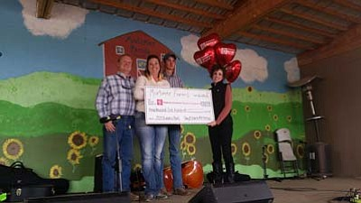 Gary, Sharla and Hayden Mortimer with Jessica Martin, director of Major Gifts & Foundation Giving of Phoenix Children's Hospital. (Courtesy photo)