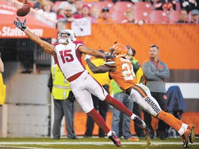 Arizona Cardinals wide receiver Michael Floyd (15) jumps but can't catch the ball under pressure from Cleveland Browns cornerback Johnson Bademosi (24) in the second half Sunday, Nov. 1, in Cleveland. (David Richard/The Associated Press)