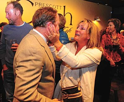 Les Stukenberg/The Daily Courier<br> Governing board member Tina Seeley congratulates Prescott Unified School District Superintendent Joe Howard as supporters of the Prescott Unified School District bond and override ballot initiatives celebrate the public's overwhelming support.