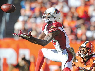 David Richard/The AP<br> Arizona Cardinals wide receiver Jaron Brown catches the ball for a first down as Cleveland Browns defensive back Tramon Williams watches in the second half of their game Sunday, Nov. 1, in Cleveland.