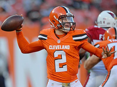 David Richard/The AP<br> Cleveland Browns quarterback Johnny Manziel passes during the NFL game against the Arizona Cardinals on Sunday, Nov. 1, in Cleveland.