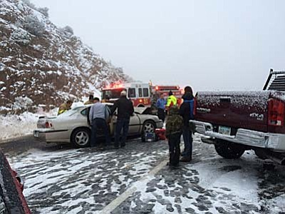Courtesy photo/ Wade Ward<br> Central Yavapai Fire District crews assist drivers involved in a head-on collision Wednesday on Iron Springs Road.