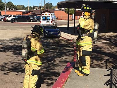 Scott Orr/The Daily Courier<br> Prescott firefighters prepare to enter rooms at Taylor Hicks Elementary School where students reported an odor Friday, Nov. 6.