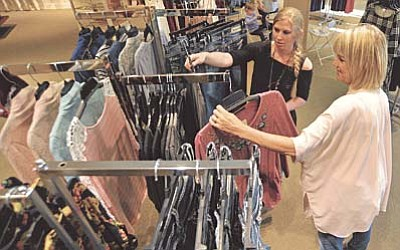 Johanna Barrett, sales associate, talks with shopper Karen Kern about their fall line of clothing inside Allie Ollie at the Prescott Gateway Mall.