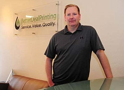 Les Stukenberg/The Daily Courier<br /><br /><!-- 1upcrlf2 -->Prescott businessman Larry Curell President/CEO of BetterDealPrinting who has begun franchising his business throughout the country.