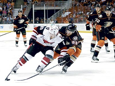 Jae C. Hong/The AP<br> Arizona Coyotes' Mikkel Boedker,left,  of Denmark, is defended by Anaheim Ducks' Jakob Silfverberg, of Sweden, during the first period of an NHL hockey game, Monday, Nov. 9, in Anaheim, California.