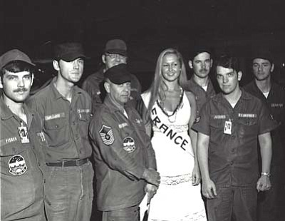 John Jacques stands to the right of Ms. France.